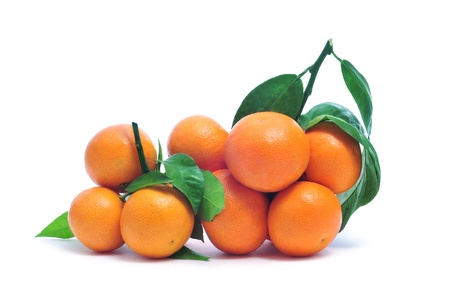 mandarin oranges: a bunch of tangerines with its leaves on a white background