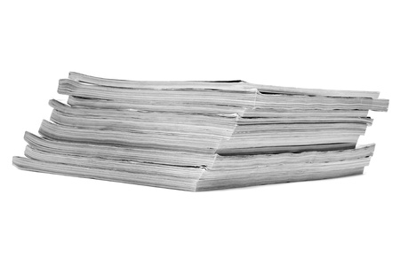 broadside: closeup of a pile of different magazines on a white background