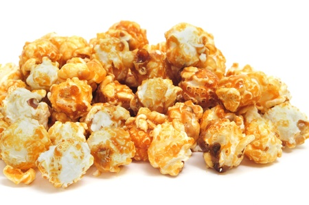 closeup of a pile of caramel corn on a white background photo