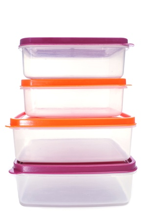 cooking ware: some plastic containers of different sizes with covers of different colors on a white background
