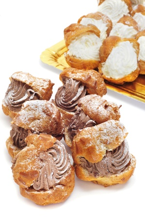 puff: closeup of some profiteroles filled with chocolate and cream Stock Photo