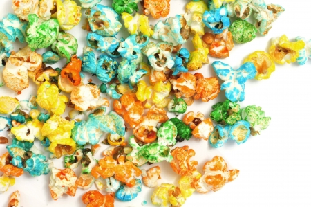 flavoured: closeup of a pile of caramel corn of different colors on a white background Stock Photo