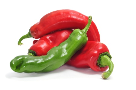 chilli: some red and green peppers isolated on a white background