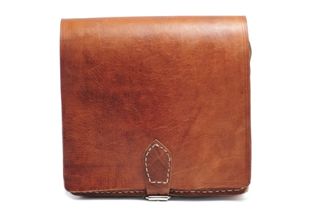 a brown leather handbag on a white background photo