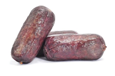 embutido: a pile of morcillas, typical Spanish blood sausages, on a white background