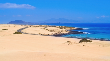 a view of Natural Park of Dunes of Corralejo in Fuerteventura, Canary Islands, Spain, with Lobos Island and Lanzarote Island in the background Stock Photo - 14476316