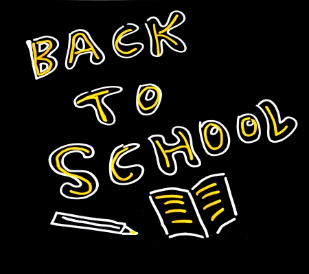 sentence back to school written in a blackboard Stock Photo - 14584834