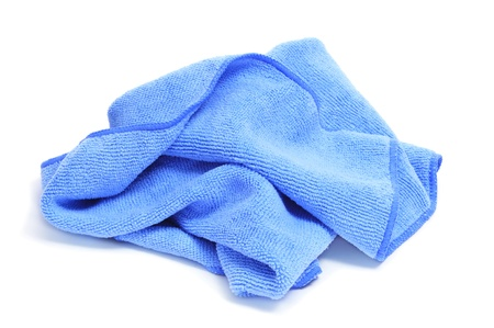 dishcloth: closeup of a blue microfiber dishcloth on a white background