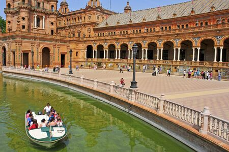 espana: Seville, Spain - May 17, 2012: View of Plaza de Espana in Seville, Spain. Plaza de Espana complex, built in 1929, is a huge half-circle with a total area of 50,000 square meters