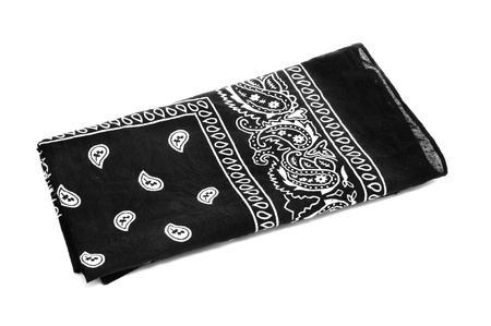 paisley patterned black black bandana handkerchief on a white white background photo