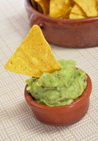 tex: a pile of nachos and guacamole served in a restaurant Stock Photo