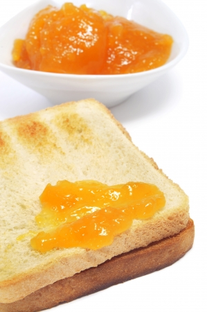marmalade: closeup of a toast with jam on a white background