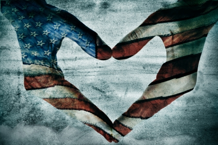 citizenship: man hands painted as the american flag forming a heart