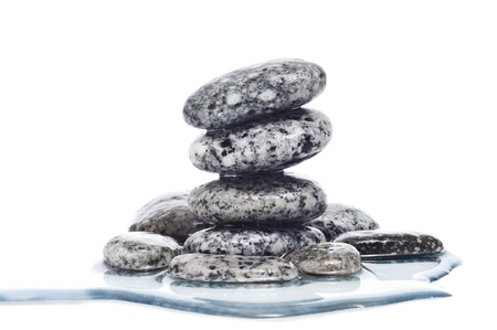 a pile of balanced zen stones covered with water on a white background Stock Photo - 14658385