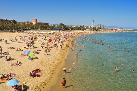 bathers: Barcelona, Spain - August 26, 2011: Bathers in Nova Icaria Beach in Barcelona, Spain. This beach, 400 m long, arised with the urban redevelopment on the occasion of the 1992 Olympic Games