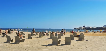 Barcelona, Spain - August 26, 2011: La Nova Icaria Beach in Barcelona, Spain. This beach, 400 meters long, arised with the urban redevelopment on the occasion of the 1992 Olympic Games