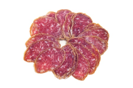 embutido: a pile of slices of salchichon, spanish salami, on a white background