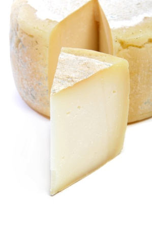 moldy: piece of cheese on a white background Stock Photo