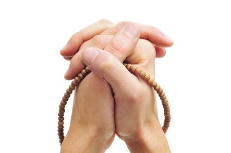 men hands clasped in prayer with prayer beads Stock Photo - 14739623