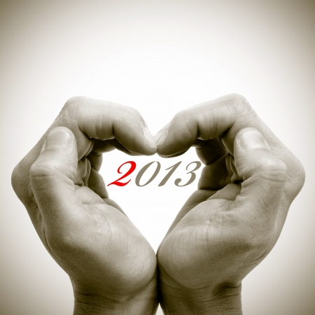 0 1 year: man hands forming a heart with the number 2013, for the new year, written inside
