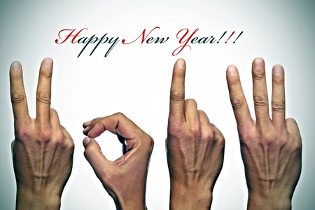 happy new year with hands forming number 2013 photo
