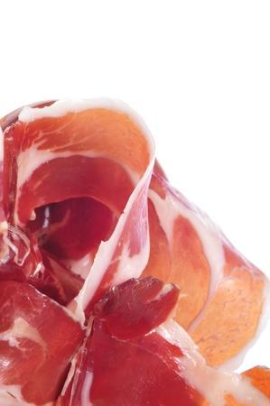 cured ham: closeup of a pile of spanish serrano ham Stock Photo