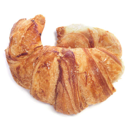 closeup of a croissant with one horn bent on a white background photo