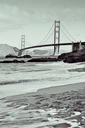 a view of Golden Gate Bridge from Baker Beach in San Francisco, United States photo
