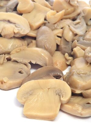 cooked sliced mushrooms on a white background photo