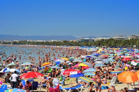 vacationers: Salou - August 10, 2012: Vacationers in Llevant Beach in Salou, Spain. Salou is a major destination for sun and beach for European tourism with more than 50,000 accommodations Editorial