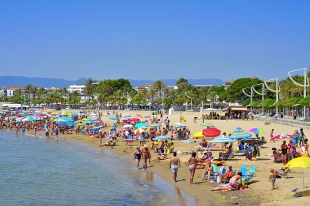 vacationers: Cambrils - August 10, 2012: Vacationers in Prat de en Fores Beach in Cambrils, Spain. This destination for sun and beach for European tourism offers more than 22,000 accommodations