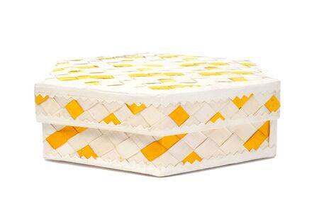 wickerwork: closeup of a basketwork box on a white background