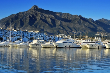 annually: Marbella, Spain - March 13, 2012: Yachts in Puerto Banus in Marbella, Spain. Puerto Banus is visited annually by nearly 5 million people and its marina has berths for 915 boats