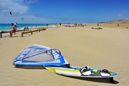 Fuerteventura, Spain - June 22, 2012: Kiteboarders in Sotavento Beach in Fuerteventura, Canary Islands, Spain. The Windsurfing and Kiteboarding World Cup is held every year in this beach
