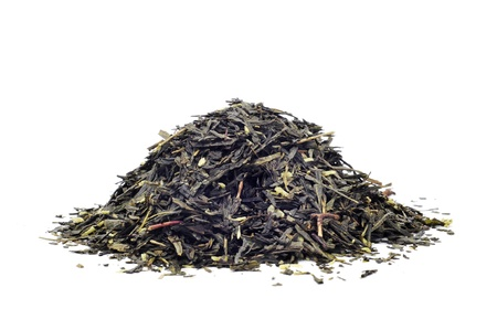 thirstiness: closeup oa pile of dry green tea leaves with bits of dry coconut ready to infuse Stock Photo
