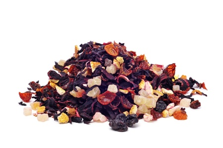 closeup of pile of a mix of dry fruits, as papaya and pineapple, and flowers, as hibiscus, to prepare herbal tea photo