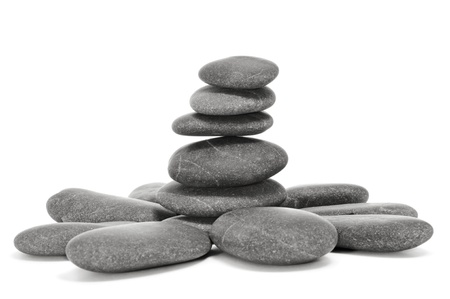 balanced: a pile of balanced zen stones on a white background
