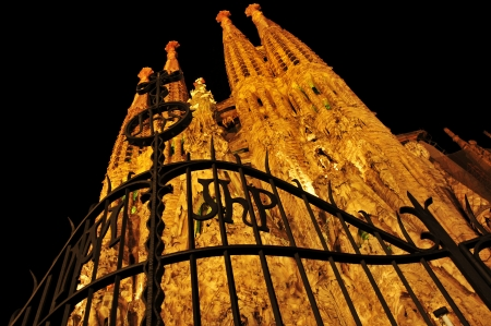 Barcelona, Spain - August 15, 2012: Sagrada Familia at night in Barcelona, Spain. The impressive cathedral designed by Antoni Gaudi is being built since 1882 and is not finished yet