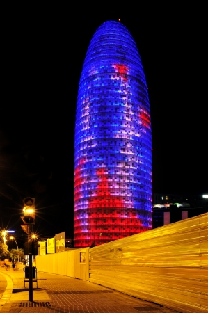 highrise: Barcelona, Spain - August 15, 2012: Torre Agbar illuminated at night in Barcelona, Spain. This 38-storey tower was designed by the famous architect Jean Nouvel Editorial