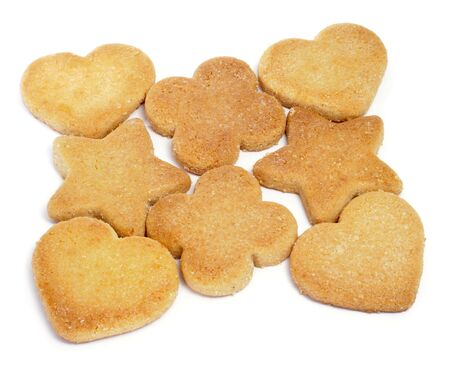 star shaped: some shortbread biscuits with different shapes on a white background Stock Photo