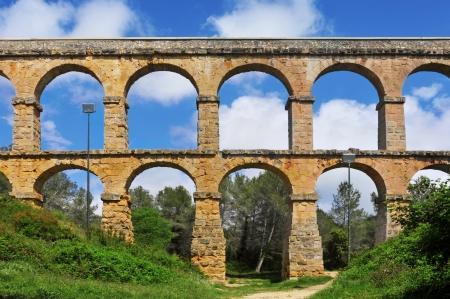 rock arch: Roman Aqueduct Pont del Diable in Tarragona, Spain
