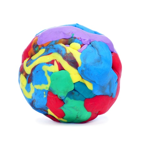putty: closeup of a ball of modelling clay of different colors on a white background