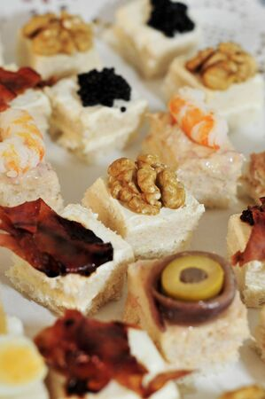 french cuisine: closeup of a pile of different canapes