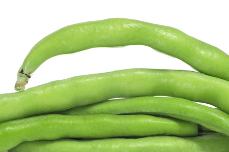 runner bean: closeup of a pile of french beans on a white background