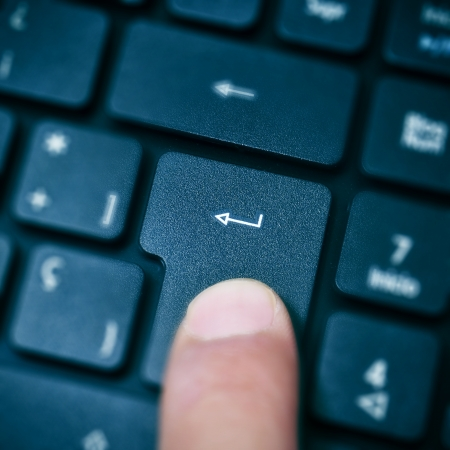 someone pressing enter key in a computer keyboard Stock Photo - 15117577