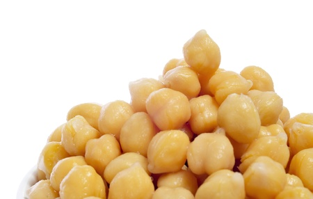 garbanzo bean: closeup of a a pile of boiled chickpeas on a white background