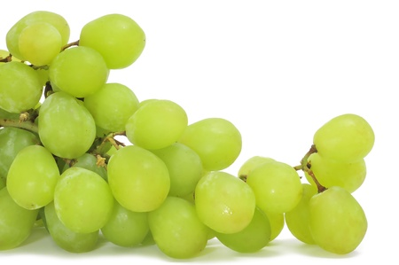 white grapes: closeup of a bunch of table grapes on a white background