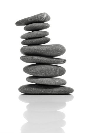 inukshuk: a pile of balanced zen stones on a white background