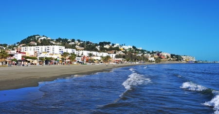Malaga, Spain - March 12, 2012: El Palo Beach in Malaga, Spain. This beach, about 1,200 meters long and 25 meters width, is full of beach restaurants where typical pescaito frito is served Stock Photo - 15102235