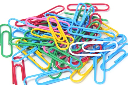 paper clips: a pile of paperclips of different colors on a white background Stock Photo